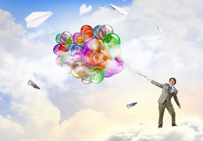 Χιουμοριστικός τύπος με τα μπαλόνια στοκ εικόνες με δικαίωμα ελεύθερης χρήσης