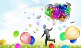 Χιουμοριστικός τύπος με τα μπαλόνια στοκ φωτογραφία