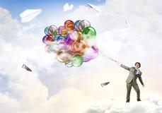 Χιουμοριστικός τύπος με τα μπαλόνια στοκ εικόνες