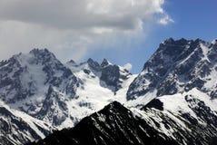 χιόνι βουνών baima στοκ εικόνες