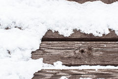 Χιόνι στον ξύλινο backround Στοκ Εικόνες