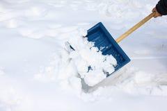 χιόνι φτυαριών Στοκ Φωτογραφίες