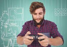 Χιλιετές άτομο που παίζει τα τηλεοπτικά παιχνίδια ενάντια στο aqua και το άσπρο συρμένο χέρι γραφείο Στοκ φωτογραφία με δικαίωμα ελεύθερης χρήσης