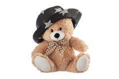 Χνουδωτός teddy αφορά με το καπέλο κομμάτων που απομονώνεται ένα λευκό στοκ εικόνες με δικαίωμα ελεύθερης χρήσης