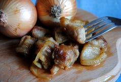 Χοιρινό κρέας ψητού με τα κρεμμύδια Στοκ Εικόνες