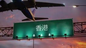 Χονγκ Κονγκ απογείωσης αεροπλάνων κατά τη διάρκεια μιας θαυμάσιας ανατολής κινεζικά απεικόνιση αποθεμάτων