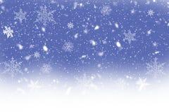 Χορεύοντας νιφάδες χιονιού σε ένα μπλε υπόβαθρο Στοκ Εικόνα