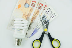Χρήματα αποταμίευσης στη χρήση της ενέργειας Στοκ φωτογραφίες με δικαίωμα ελεύθερης χρήσης