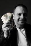 χρήματα ατόμων εκμετάλλε&upsil Στοκ Φωτογραφίες