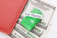 Χρήματα αυτοκινήτων με το σημάδι - ενοίκιο αυτοκινήτων Πληρωμές και δαπάνες στοκ εικόνα