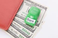 Χρήματα αυτοκινήτων με το σημάδι - τράπεζα Πληρωμές και δαπάνες στοκ εικόνα