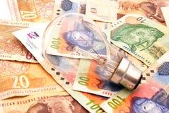 χρήματα βολβών Στοκ Εικόνες