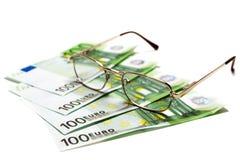 χρήματα γυαλιών Στοκ Φωτογραφίες