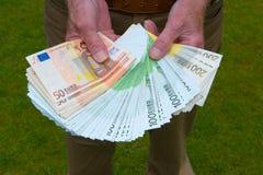Χρήματα εγγράφου στα χέρια Στοκ εικόνα με δικαίωμα ελεύθερης χρήσης