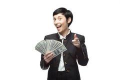 Χρήματα εκμετάλλευσης επιχειρησιακών γυναικών Στοκ Εικόνες