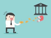 Χρήματα επιχειρηματιών μαγνητών τράπεζας Στοκ εικόνα με δικαίωμα ελεύθερης χρήσης