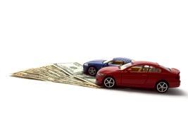 Χρήματα και αυτοκίνητα - η μετακίνηση Στοκ φωτογραφία με δικαίωμα ελεύθερης χρήσης