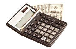 Χρήματα και υπολογιστής πέρα από το λευκό στοκ φωτογραφία με δικαίωμα ελεύθερης χρήσης