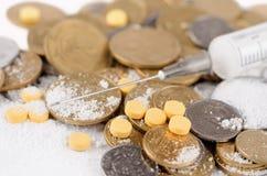 Χρήματα και φάρμακα Στοκ Φωτογραφίες