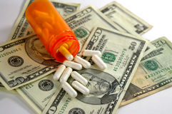 Χρήματα και φάρμακο Στοκ εικόνα με δικαίωμα ελεύθερης χρήσης