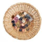 χρήματα καλαθιών Στοκ Εικόνες