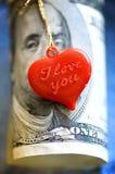 χρήματα καρδιών Στοκ Φωτογραφίες