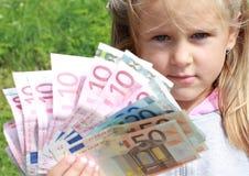 χρήματα κοριτσιών Στοκ Φωτογραφίες