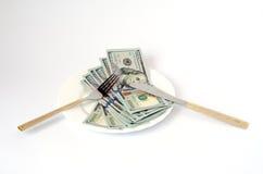Χρήματα με τα μαχαιροπήρουνα Στοκ φωτογραφία με δικαίωμα ελεύθερης χρήσης