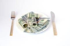 Χρήματα με τα μαχαιροπήρουνα Στοκ Εικόνες