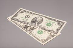 Χρήματα λογαριασμοί δολαρίων Αμερικανού ένα και δύο Στοκ Φωτογραφία