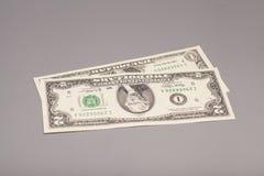 Χρήματα λογαριασμοί δολαρίων Αμερικανού ένα και δύο Στοκ εικόνες με δικαίωμα ελεύθερης χρήσης