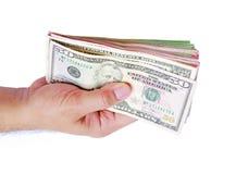 Χρήματα δολαρίων που παρουσιάζουν στο χέρι ατόμων ` s στο άσπρο υπόβαθρο Στοκ φωτογραφίες με δικαίωμα ελεύθερης χρήσης