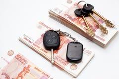 χρήματα πλήκτρων σπιτιών αυ&ta Στοκ εικόνες με δικαίωμα ελεύθερης χρήσης