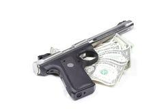 χρήματα πυροβόλων όπλων Στοκ εικόνα με δικαίωμα ελεύθερης χρήσης