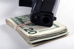 χρήματα πυροβόλων όπλων Στοκ Εικόνα