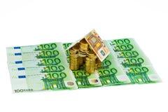 χρήματα σπιτιών νομισμάτων Στοκ Φωτογραφία
