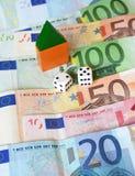 χρήματα σπιτιών τυχερού παιχνιδιού Στοκ Εικόνα