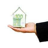 χρήματα σπιτιών χεριών Στοκ εικόνες με δικαίωμα ελεύθερης χρήσης