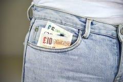 Χρήματα στην τσέπη του Jean Στοκ Φωτογραφία