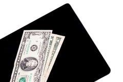 Χρήματα στην ψηφιακή ταμπλέτα στοκ εικόνες