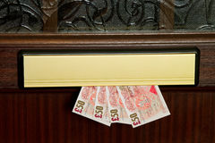 χρήματα ταχυδρομικών θυρί&de Στοκ φωτογραφία με δικαίωμα ελεύθερης χρήσης