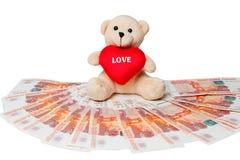 Χρήματα Το Teddy αφορά τα χρήματα διαφορετικά χρήματα χωρών στοκ εικόνες