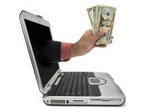 χρήματα lap-top στοκ φωτογραφία