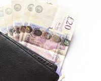 χρήματα UK Βρετανικές 20 λίβρες λογαριασμών και πορτοφόλι στοκ εικόνα