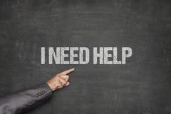 Χρειάζομαι τη βοήθεια με το χέρι που δείχνει στον πίνακα Στοκ φωτογραφία με δικαίωμα ελεύθερης χρήσης