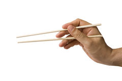 χρησιμοποίηση ραβδιών χεριών μπριζολών Στοκ φωτογραφία με δικαίωμα ελεύθερης χρήσης