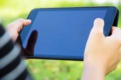 Χρησιμοποίηση του ψηφιακού υποβάθρου ταμπλετών Στοκ Εικόνες