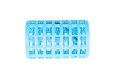 Χρησιμοποιημένες μπλε πλαστικές ρόλερ και τρίχα που χάνεται που απομονώνονται Στοκ Εικόνες