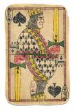 Χρησιμοποιημένος Antigue παίζοντας βασιλιάς καρτών των φτυαριών που απομονώνεται Στοκ Φωτογραφίες