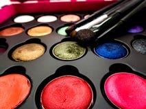 Χρησιμοποιημένο καλλυντικό μαξιλάρι, σκιά ματιών, brusher σκαφών της γραμμής ματιών, χείλι, highl Στοκ Φωτογραφία
